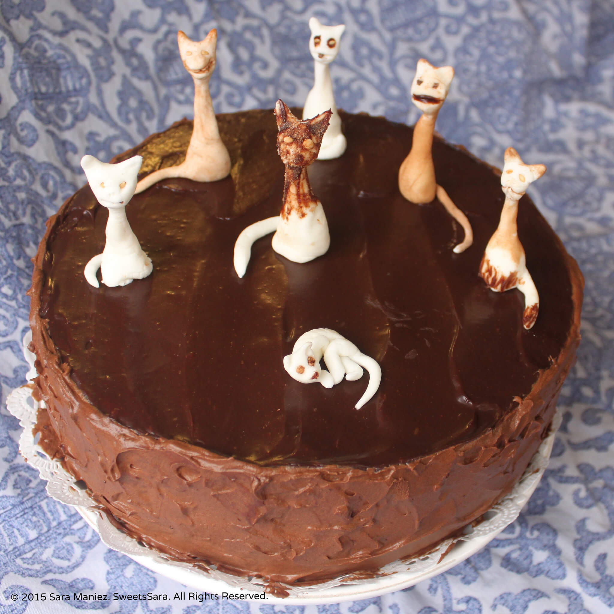 Almond Fondant Felines adorn this chocolate cake with mocha frosting times two.