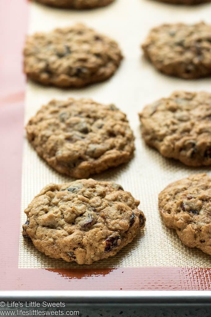 Oatmeal Raisin Cranberry Cookies cooling on a baking mat