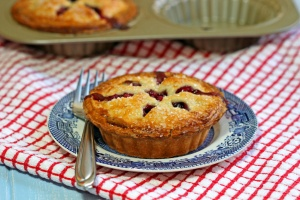 In these Apple Berry Mini Pies the fruit of strawberries, blackberries and honeycrisp apples are encased in a wonderfully buttery, flakey pastry dough