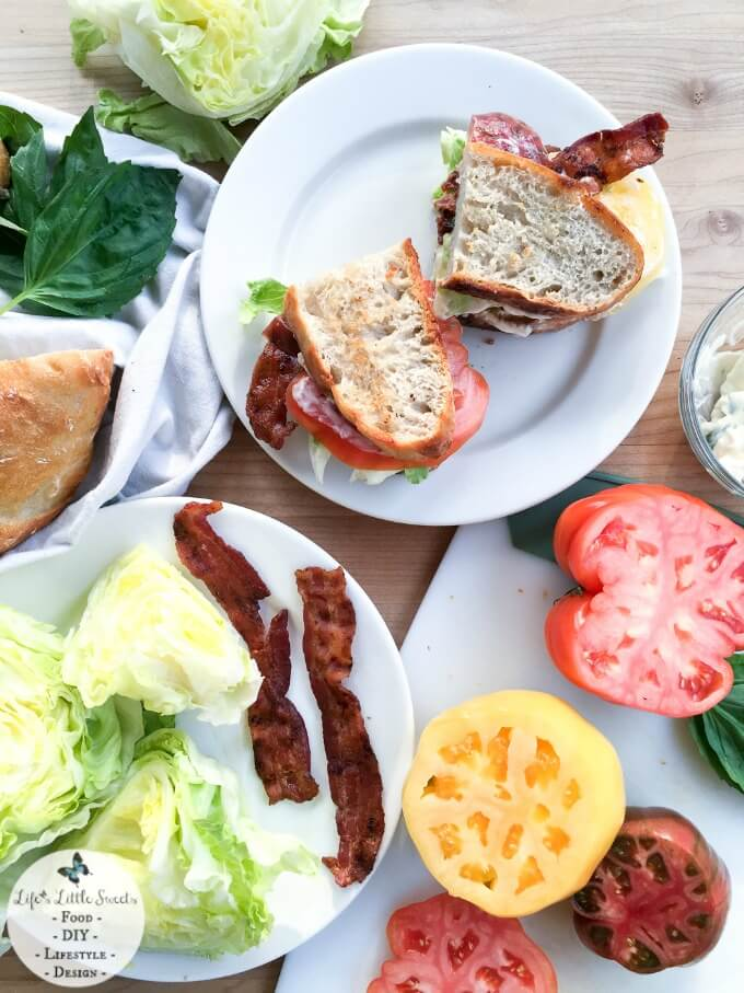 This Rustic BLT Sandwich is an ode to the the classic BLT with a rustic twist. It has homemade, no-knead bread, heirloom tomatoes, savory Applewood smoked bacon, crisp Iceberg lettuce and basil mayonnaise. This Rustic BLT Sandwich with its emphasis on whole ingredients and delicious flavor is inspired by DISH from Rachael Ray™ Nutrish®.