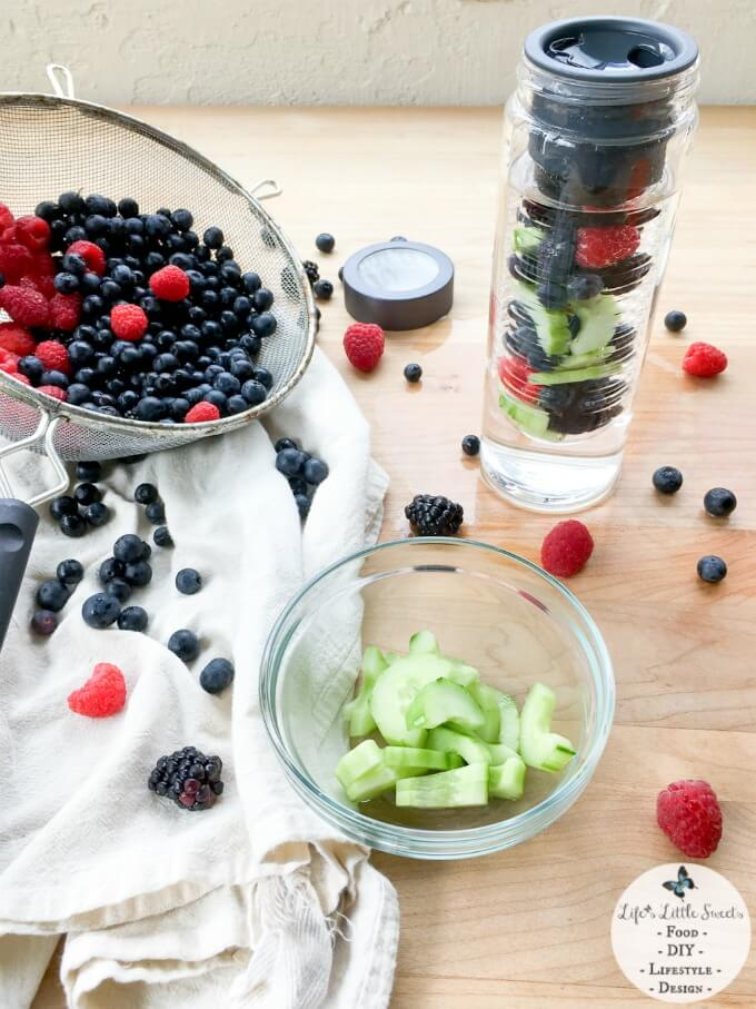 Triple Berry Cucumber Spa Water - Try this recipe for Triple Berry Cucumber Spa Water and you will have a fresh way to stay hydrated on the go. The bonus of having this refreshing, infused water is that you have a delicious berry and cucumber medley to snack on after you finish your water :) Check out my review of this Flavor Infuser Water Bottle from Uncommon Goods!