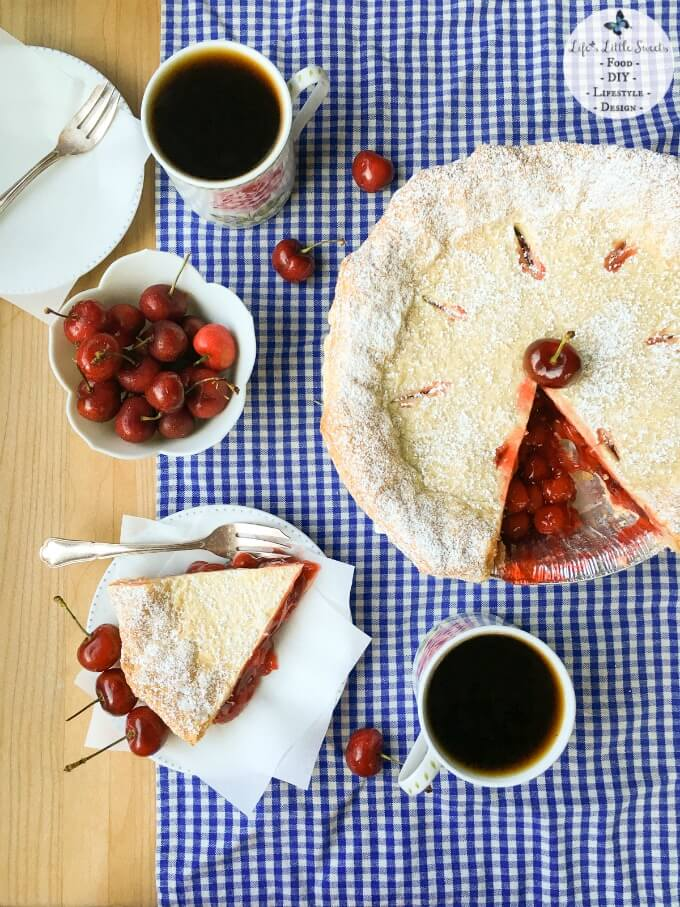 FoodieMamas 2015 and 2016 Recipe Roundup | This Easy Cherry Pie with Puff Pastry Crust comes together in 50 minutes with ready-made ingredients and has a touch of unique with a light and crisp puff pastry crust. Enjoy a delicious slice topped with ice cream, whipped cream and fresh cherries! Check out all the #FoodieMamas Cherry Recipes in the roundup!