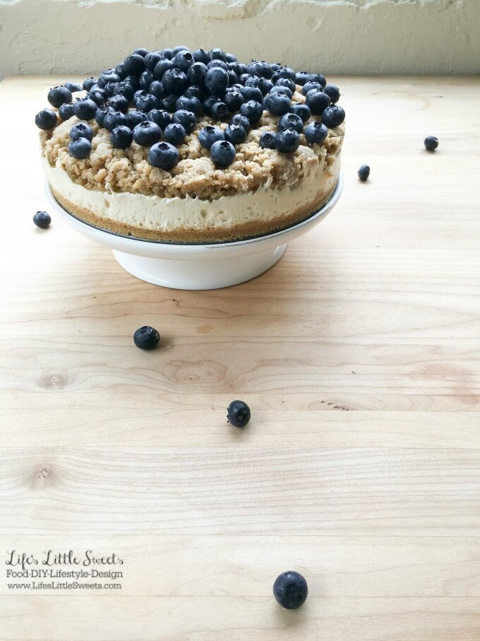 This No Bake Blueberry Lemon Crumble Cheesecake is delicious, zesty and filled with fresh blueberries! Top it off with some Vanilla Whipped Cream for a perfect no bake, Summer dessert!