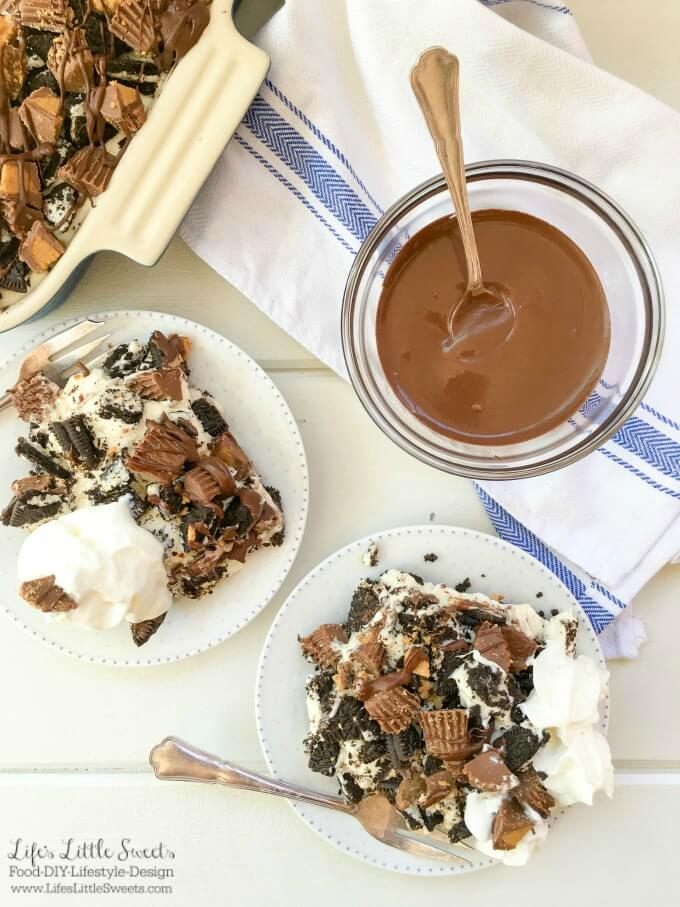 ? This One-Pan Peanut Butter Cup Oreo No Bake Cheesecake combines cheesecake with Oreo cookies and Reese's Peanut Butter Cups to create a decadent dessert! Bring this rich and creamy, no bake, layered dessert to your next gathering for everyone to enjoy.