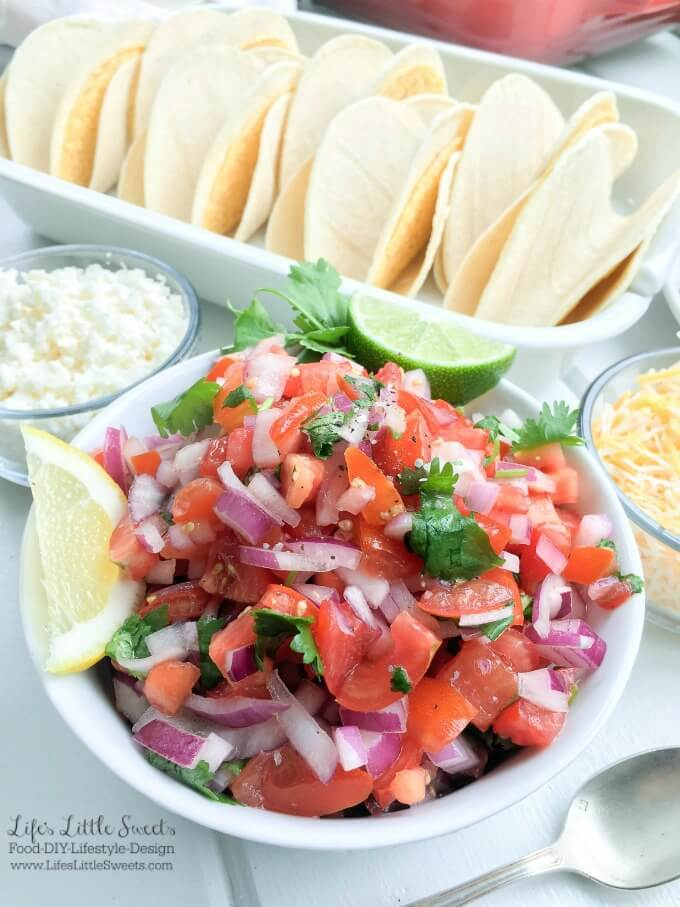 Salmon Tacos with Fresh Salsa and Avocado Sauce - These Salmon Tacos have homemade fresh salsa and a cilantro avocado sauce which will thrill your taste buds. This delicious and satisfying recipe is perfect for game day or a family dinner! #taco #avocadosauce #salsa #citrus #lemon #salmon #tortillas #cheese #lettuce #cabbage