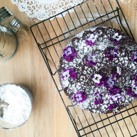 ? This Single Layer Chocolate Cake with Edible Flowers is a pretty and simple chocolate cake that can be whipped up when you have the need or craving for chocolate cake. No need for frosting for this elegant cake as it is decorated with confectioner's sugar and edible flowers.