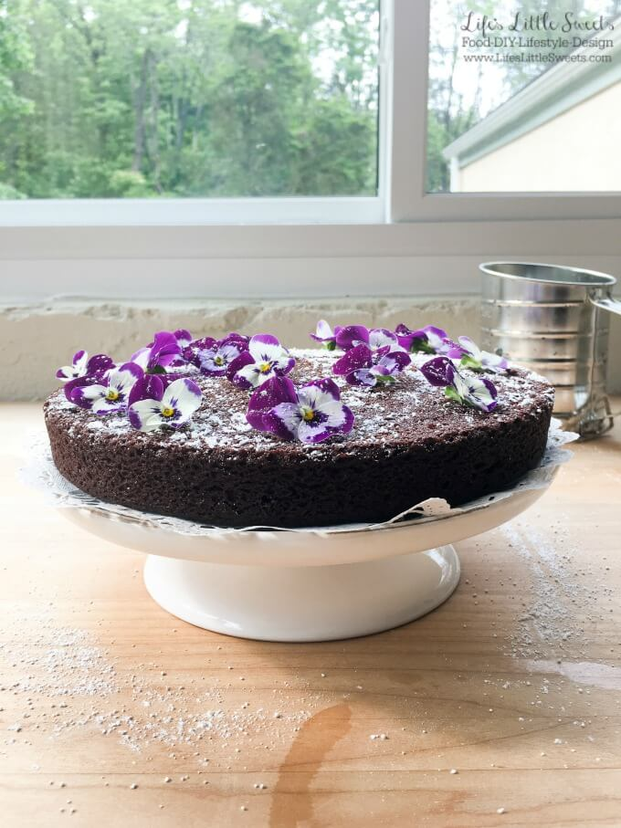 ? This Single-Layer Chocolate Cake with Edible Flowers is a pretty and simple chocolate cake that can be whipped up when you have the need or craving for chocolate cake. No need for frosting for this elegant cake as it is decorated with confectioner's sugar and edible flowers.