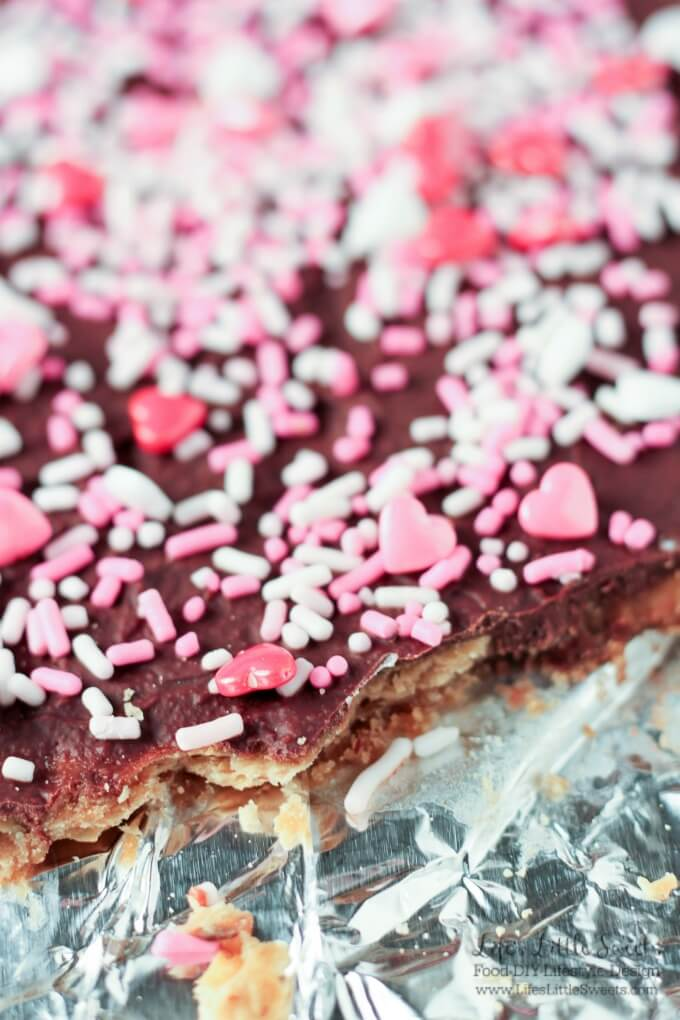 Valentine's Day Saltine Toffee with pink and white sprinkles