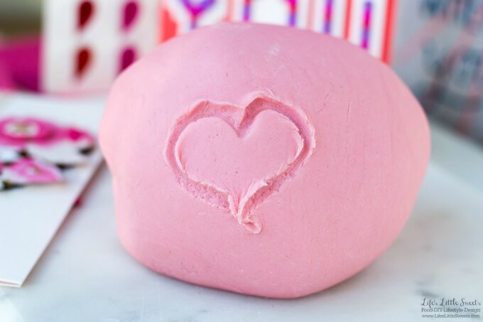 This DIY Valentine's Day Playdough Recipe is an easy kids activity that you can do for a classroom or teacher's gift for Valentine's Day along with Hallmark Signature Valentine's Day Cards. It only takes only a few minutes, 5 ingredients (minimum) to make and lasts for months! (makes about 1 lb. 11.6 ounces) #SendingYourLove #CollectiveBias #ad @Walmart #playdough #diy #kidsactivities #pink