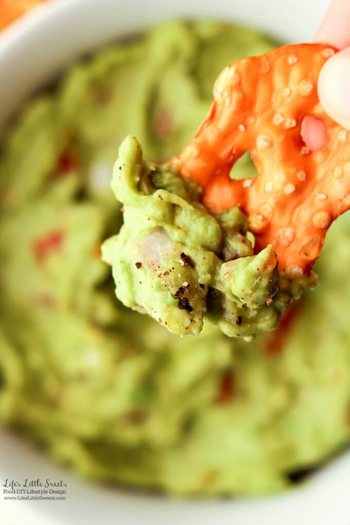 Yummy bite | This Easy Guacamole is fresh and a perfect recipe for Spring and Summer. A simple recipe with red onions, fresh chopped tomatoes and a spritz of lime, enjoy it for any gathering, game day or a quick snack for yourself!