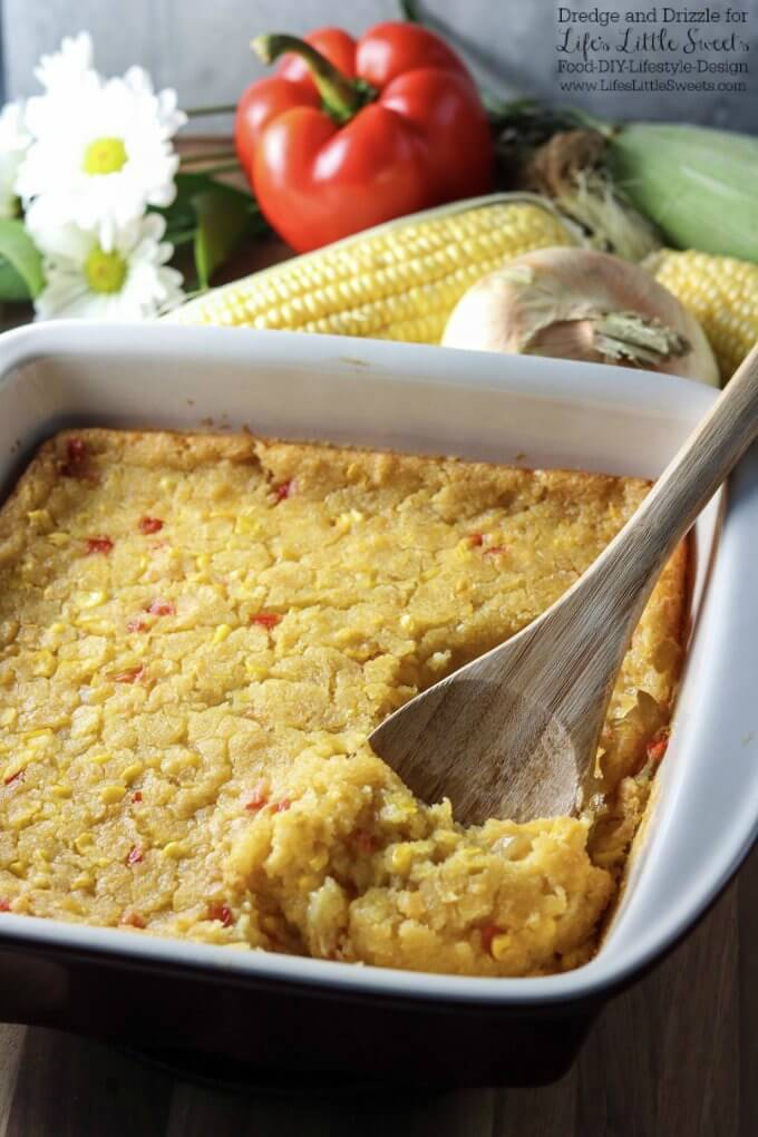 Perfect for any holiday! | If there were a non-traditional dessert you could eat right along with a meal, this Corn Soufflé would be it. It's creamy and sweet and uses corn three ways; fresh corn right off the cob, creamed corn, and corn meal. Corn Soufflé is the perfect side dish to a cookout, weeknight dinner, or holiday meal. Little nuggets of onion and sweet red bell pepper give it even more fresh-from-the-garden flavors. Dredge and Drizzle for www.lifeslittlesweets.com