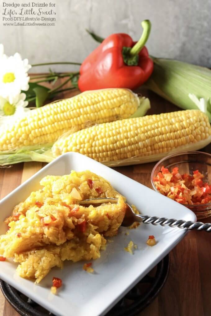Delicious and satisfying | If there were a non-traditional dessert you could eat right along with a meal, this Corn Soufflé would be it. It's creamy and sweet and uses corn three ways; fresh corn right off the cob, creamed corn, and corn meal. Corn Soufflé is the perfect side dish to a cookout, weeknight dinner, or holiday meal. Little nuggets of onion and sweet red bell pepper give it even more fresh-from-the-garden flavors. Dredge and Drizzle for www.lifeslittlesweets.com