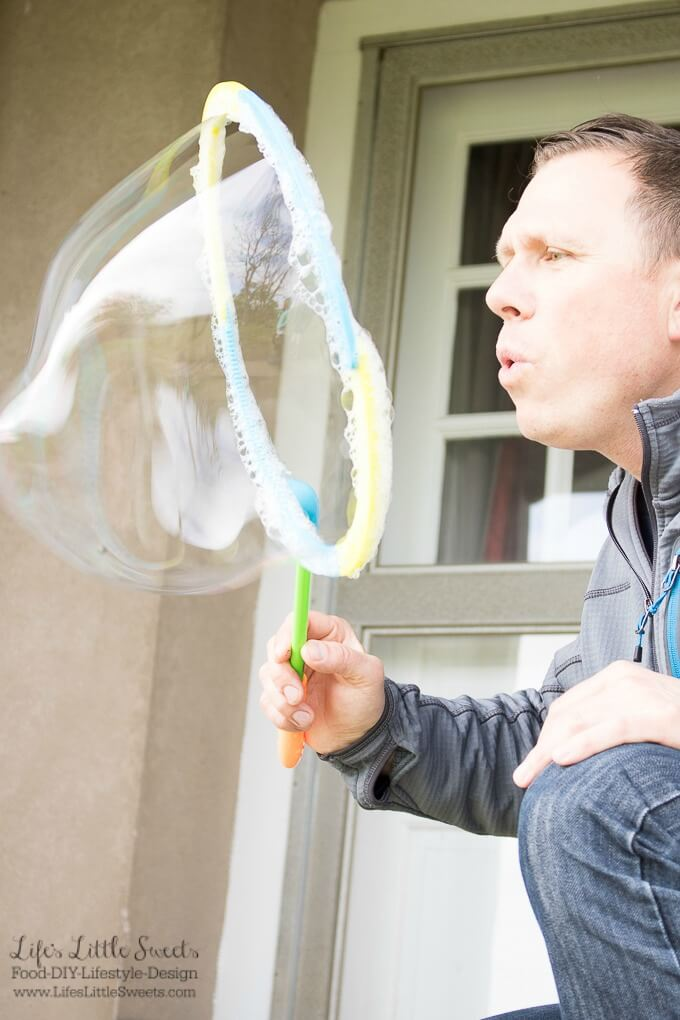 """This DIY Bubble Mixture Recipe is sure to please """"kids"""" of all ages. It's the perfect activity for kids vacations or to have on hand for everyday use. Why buy bubbles from the store when you can make them at home? www.LifesLittleSweets.com"""