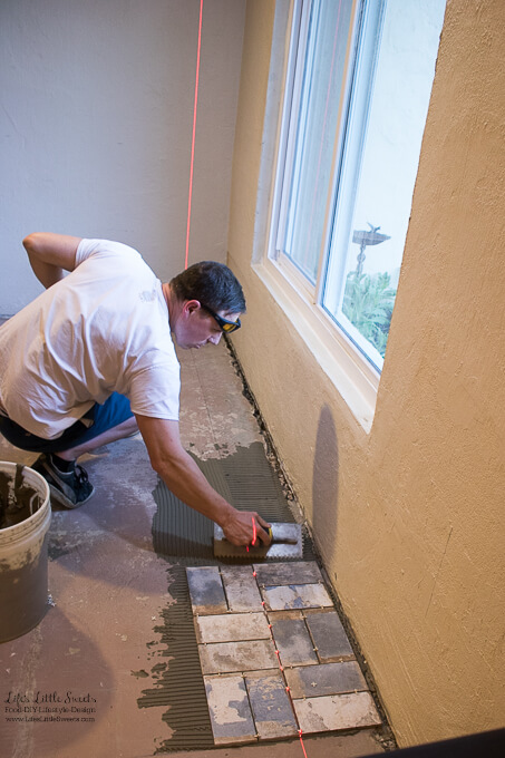 4. Eric just starting the corner of the room, close to the living room | Kitchen Renovation New Tile Floor – Check out the latest from the Life's Little Sweets home kitchen renovation being our tile floor odyssey this past week (and other updates with 45 photos!)