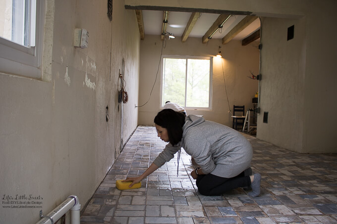 28. Aaaaannnnd, that's how you destroy your knees! Sara wiping down the tile after Eric grouted the tile. | Kitchen Renovation New Tile Floor – Check out the latest from the Life's Little Sweets home kitchen renovation being our tile floor odyssey this past week (and other updates with 45 photos!)
