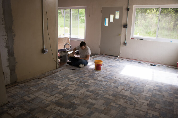 30. Eric installing the cut tile pieces and the threshold tiles after our family visit to the tile store. | Kitchen Renovation New Tile Floor – Check out the latest from the Life's Little Sweets home kitchen renovation being our tile floor odyssey this past week (and other updates with 45 photos!)