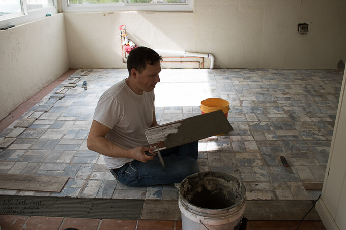 35. Eric is determined to lay down the last of the tile on Sunday! Bravo Eric! | Kitchen Renovation New Tile Floor – Check out the latest from the Life's Little Sweets home kitchen renovation being our tile floor odyssey this past week (and other updates with 45 photos!)