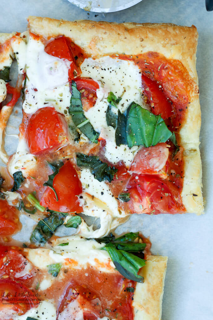 This Tomato Basil Mozzarella Puff Pastry Tart recipe is an easy, Summer-y and savory meal to make. No pizza dough making required! #pizza #tart #tomato #basil #puffpastry #recipe #Mozzarella #tomatosauce #caprese