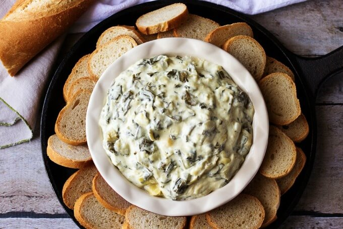 Simple Spectacular Spinach Artichoke Dip - Try our simple spectacular spinach artichoke dip made with three kinds of cheese. It's cheesy, warm, and delicious! Berly's Kitchen for www.lifeslittlesweets.com