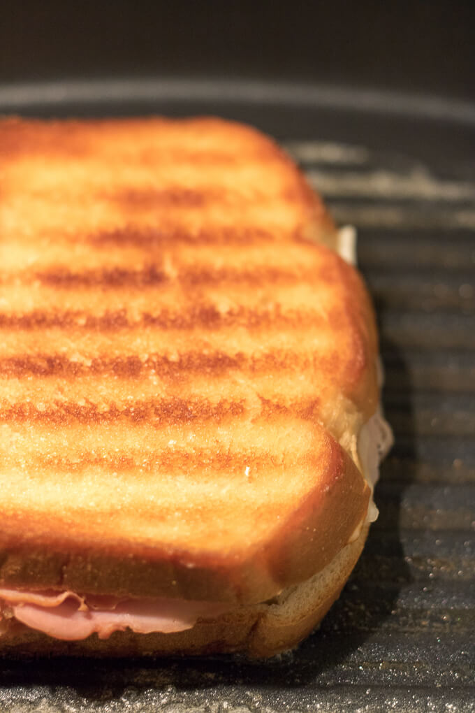 This Grilled Cheese Ham Sandwich has 2 kinds of cheese, Eckrich Virginia Brand Ham and sliced bread.