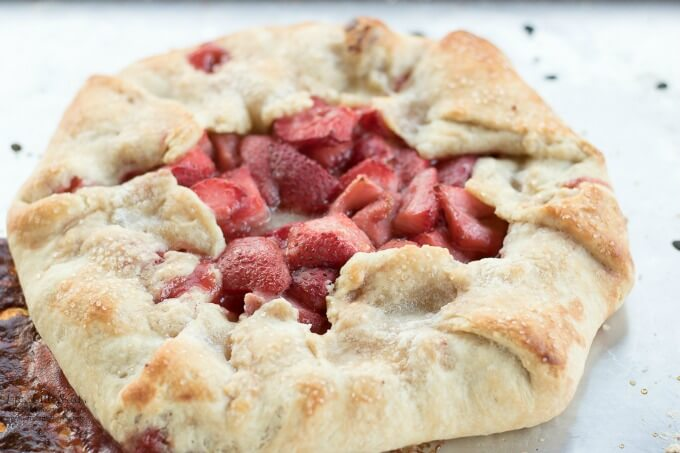 Strawberry Galette is a sweet, delicious, Summer and garden-inspired dessert recipe filled with ripe strawberries and encased in a homemade, flakey pie crust. It goes perfectly with a large scoop of vanilla ice cream! (6-8 servings)