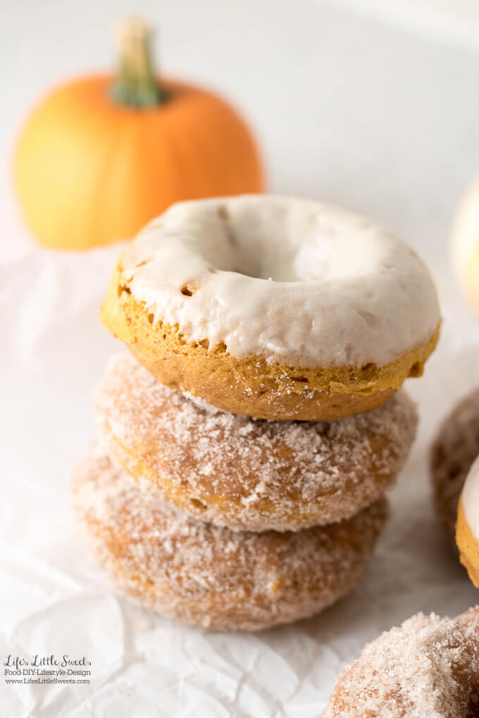 These Pumpkin Spice Baked Donuts are moist, baked, cake donuts and can be topped with a pumpkin spice - sugar mixture and/or a maple glaze. Enjoy them with coffee or tea on a Autumn day! (makes 12-13 donuts)