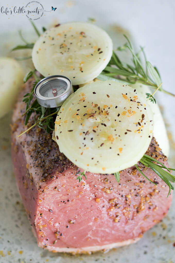 This Garlic Herb Eye of the Round Roast is a savory, flavorful and meaty main dish for the dinner table. This roast is seasoned with fresh herbs like thyme, rosemary and garlic, onions and Montreal Steak Seasoning. Easy to make for a weeknight or holiday dinner alike.  (gluten-free) #glutenfree #roast #eyeoftheround #thyme #rosemary #Montrealsteakseasoning #garlic