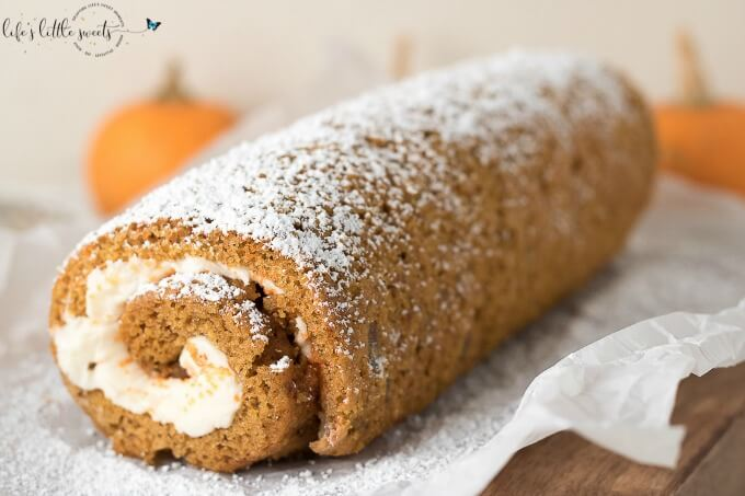 This Pumpkin Roll Recipe is the perfect recipe to feature on the Thanksgiving or Christmas dessert table! This Pumpkin Roll is a thin, moist pumpkin cake with or without walnuts, filled with a creamy frosting mixture and wrapped into a swirl of sweet heaven! (makes 1 roll, 10 slices) #pumpkinroll #pumpkin #dessert #pumpkinspice #pumpkinrollrecipe #creamcheese #cake