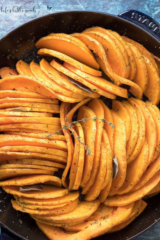This Skillet Oven Roasted Butternut Squash is sliced thin, seasoned with herbs like thyme and sage and then baked in the oven. Enjoy this easy, tasty and beautiful way to enjoy butternut squash! (vegan, gluten-free) #butternutsquash #baked #roasted #sage #thyme #vegan #glutenfree #sliced