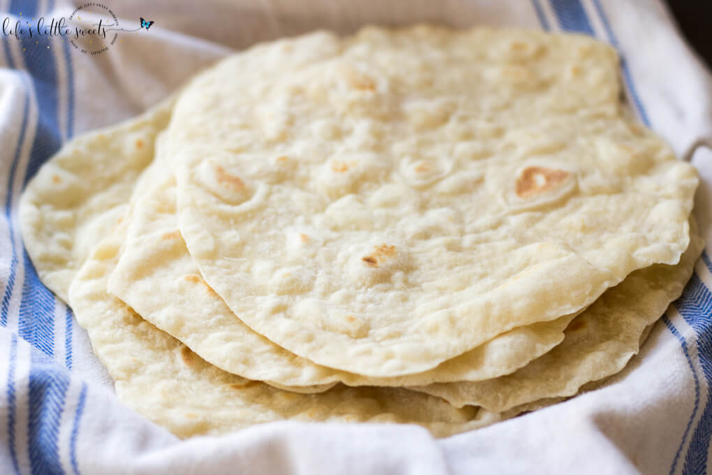 These Homemade Flour Tortillas are so wholesome and good; it's such a difference having homemade tortillas over store bought. They are perfect for wraps, dipping in sauces and to have with dinner. Only 5 ingredients! (vegan) #flour #homemade # coconutoil #vegan #vegetarian #tortillas