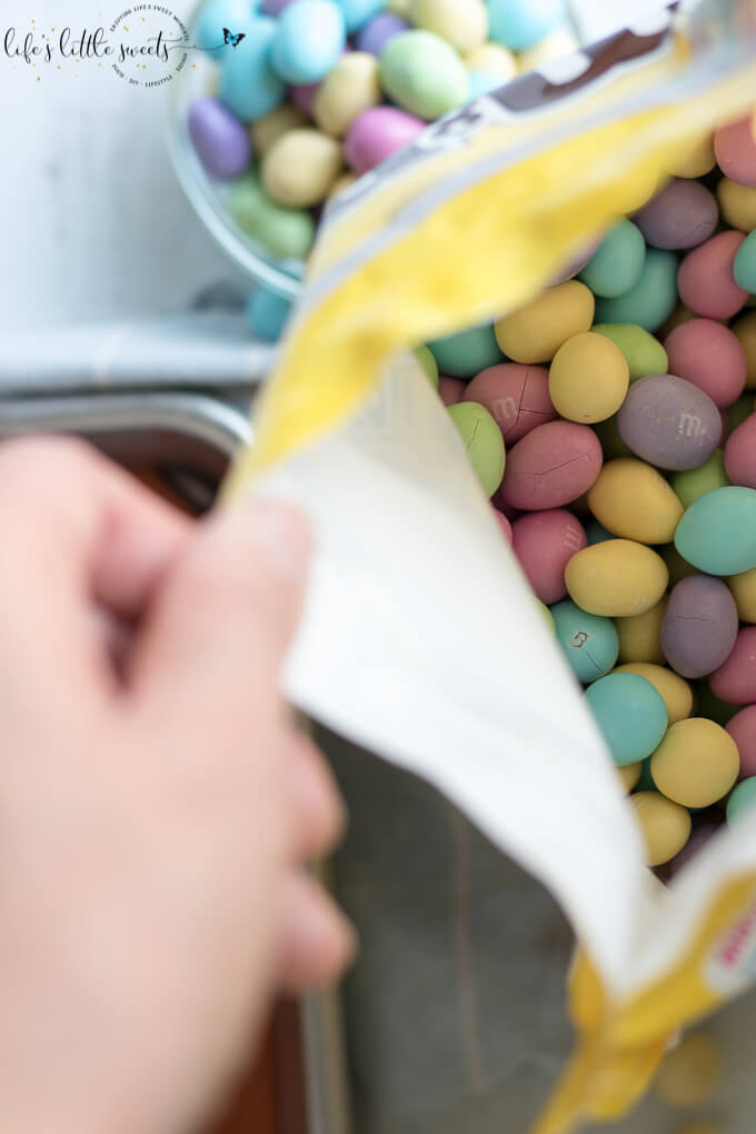 Chocolate Peanut Butter Eggs are a homemade, no bake, sweet, dessert candy and are perfect for Spring and Easter season! They are made with simple pantry staples and are decorated with M&M'S® Pastel Peanut Chocolate Candy from Sam's Club. Try this easy and fun recipe today! #SpringMoments #CollectiveBias #ad @mmschocolate @samsclub #chocolate #peanutbutter #Easter #Spring #candy #Springtime #Eastereggs #recipe #food #sweet #dessert