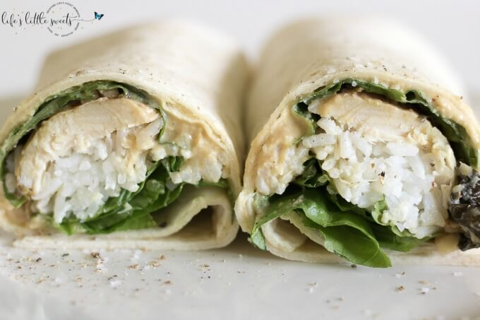 This Chicken Rice Hummus Wrap recipe is a perfect way to use up chicken leftovers and have a healthy, filling lunch at the same time. #chicken #rice #hummus #Romainelettuce #wrap #flourtortilla #sandwich