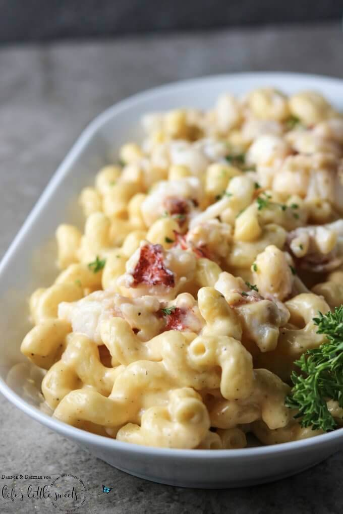 Looking to bring the ocean to your family's dinner table? This Lobster Macaroni & Cheese is creamy and warm and buttery with a hint of Old Bay seasoning... a huge crowd-pleaser! #lobster #pasta #macncheese #seafood #cheese #recipe #macaroni