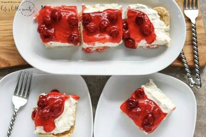 Looking for something quick to throw together for a get-together or just a special treat for the family? Look no further than this Easy Cherry Cheesecake! It's not too sweet with a creamier texture than traditional cheesecake. And if cherries aren't your thing, you can easily swap out the topping! #cake #dessert #sweet #cherries #cherry #cheesecake