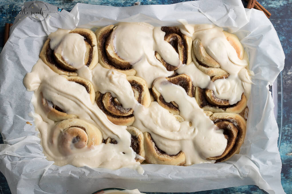 These Homemade Cinnamon Buns are a classic recipe and they are topped with cream cheese frosting. These gooey cinnamon rolls satisfy your sweet craving and they feed a crowd – perfect for holiday or weekend mornings! (makes 12 rolls) #homemade #cinnamonrolls #cinnamonbuns #recipe #classic #cinnamon #creamcheese #frosting #frosted #yeast