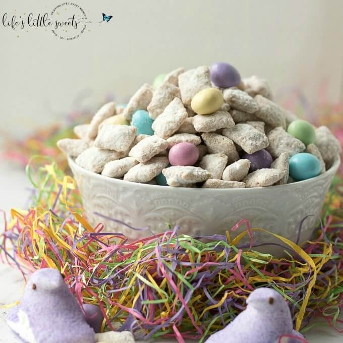 This Easter Muddy Buddies Recipe are a sweet and salty dessert snack with cereal coated in white chocolate and peanut butter, customized with your favorite Easter-themed candies. Try this delicious snack at your next Easter or Springtime gathering! #Spring #recipe #chocolate #M&Ms #peanutm&ms #snack #candy #muddybuddies #puppychow #Chex #ricecereal #Easter