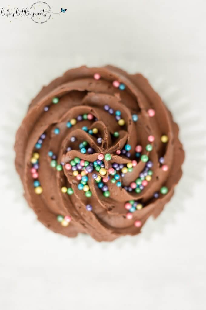 This Chocolate Buttercream Frosted Chocolate Cupcakes recipe is a classic, moist, chocolate cupcake recipe. They are topped with deliciously decadent chocolate buttercream frosting and your favorite sprinkles. (makes 24 cupcakes) #chocolate #buttercream #cupcakes #frosted #recipe #homemade #sprinkles #icing #buttermilk