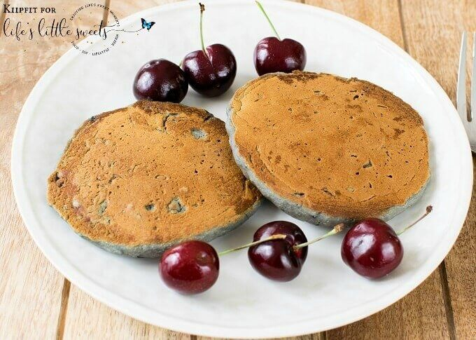 These soft, fluffy and nutritious Cherry Oatmeal Pancakes are delectable to the taste buds. These pancakes are made with real ingredients and are super easy to make. In just few minutes a mouthwatering and family friendly breakfast/brunch gets ready. These pancakes are worth devouring every bite and you would crave for more. #vegan #pancakes #cherries #oatmeal #breakfast #oatflour