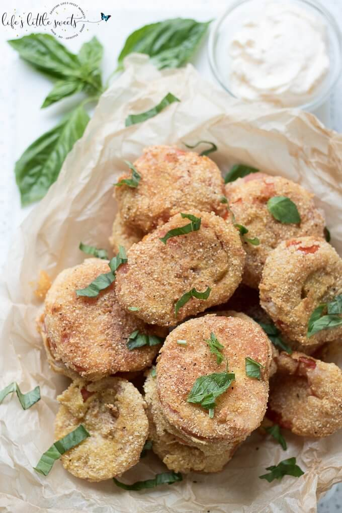 Gluten Free Fried Tomatoes are a delicious Summer appetizer or vegetarian side dish - juicy, ripe, red tomatoes with a gluten free flour, egg, milk and corn flour coating fried in Canola oil make for a crispy outer texture, sprinkle with fresh basil! #tomatoes #cornmeal #glutenfree #fried #canolaoil #appetizer #tomatoseason #friedtomatoes #basil