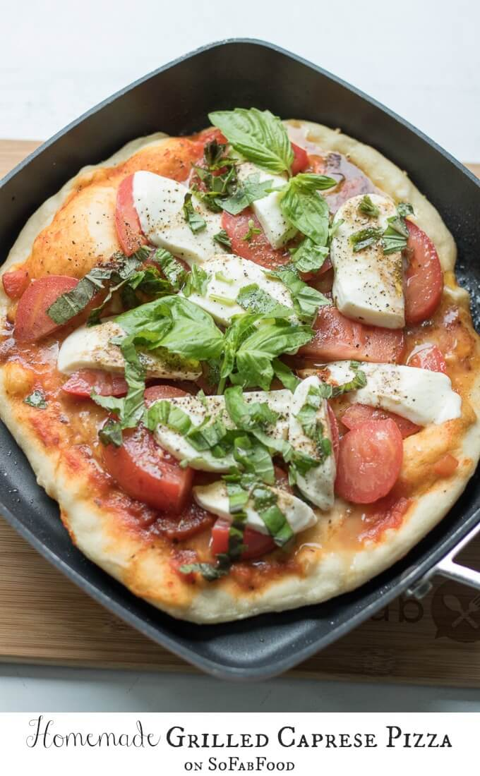 This Caprese Pizza is topped with ripe tomatoes, fresh basil, sliced mozzarella and drizzled with an olive oil-balsamic dressing. Make this homemade pizza for a bistro dinner at home! (makes 2 individual pizzas or 1 large pizza)