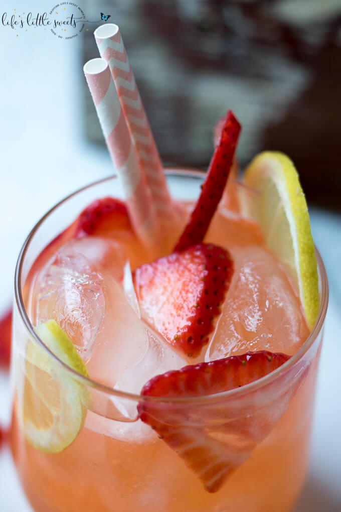 Strawberry Lemonade is the perfect iced beverage for Strawberry season! Give your classic lemonade a twist with this delicious and thirst quenching drink! #lemons #strawberry #strawberries #drink #iced #lemonade
