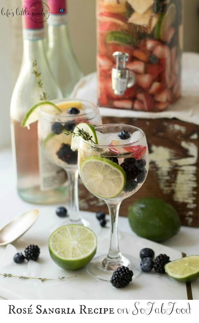 This Rosé Sangria recipe is a light and fruity summer cocktail that's perfect for using those fresh farmers market finds. Serve this refreshing drink for Sunday brunch or outdoor entertaining and you're sure to impress guests! #ad @sofabfood #rose #fruit #lime #strawberry #wine #berries #blueberries #thyme #Summer