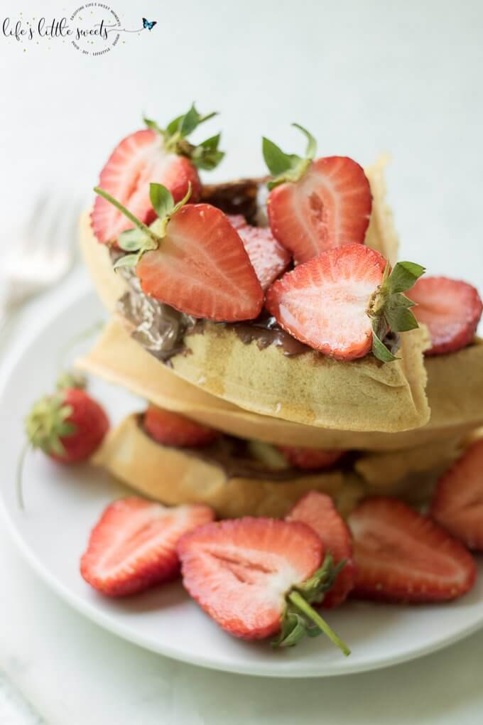 Having Strawberry Nutella Waffles is a sweet, chocolate-y and fresh way to start the day. Be it a weekday or family brunch, this pleasing combination of fresh strawberries, hazelnut-chocolate Nutella and maple syrup flavors with freshly made waffles is sure to please. #Nutella #strawberries #waffles #maplesyrup #breakfast
