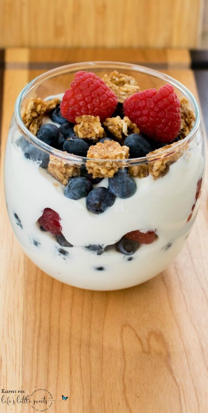This Healthy Breakfast Yogurt Parfait is easy to whip up and uses only three ingredients to make your morning routine super easy and lip smacking. #vegan #parfait #breakfast #granola #yogurt #healthy #snack #blueberries #raspberries #berries