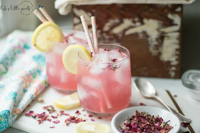 This Rosewater Lemonade is a thirst-quenching classic lemonade recipe with a fragrant and floral twist. Try this unique and beautiful lemonade for your next gathering! #rosewater #lemonade #drink #rose #roses #lemons #lemon #beverage #recipe #sweet