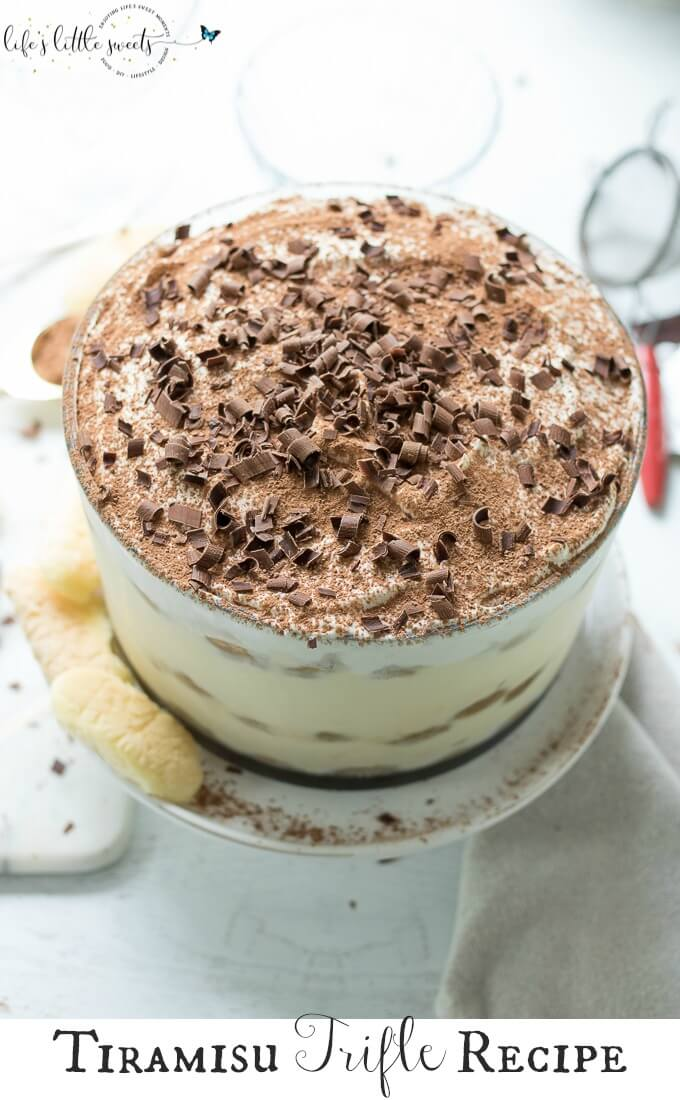This Tiramisu Trifle has delicate ladyfinger sponge cakes soaked in an espresso-rum mixture, layered with a rich Mascarpone-whipped cream mixture and topped with vanilla whipped cream, cocoa powder and semi sweet chocolate curls. #tiramisutrifle #trifle #dessert #espresso #tiramisu #trifle #chocolate #Mascarpone #ladyfingers