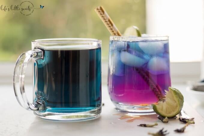 This Blue Butterfly Pea Flower Tea recipe can be enjoyed either hot or cold and tastes delicious with lemon or lime which changes the color from an indigo blue to a purple-pink! You can also add wildflower honey to sweeten this delicious and refreshing tea drink. #tea #icedtea #hottea #bluebutterflypeaflowertea #peaflower #peaflowertea #galaxy #galaxytea #lime #honey #glutenfree