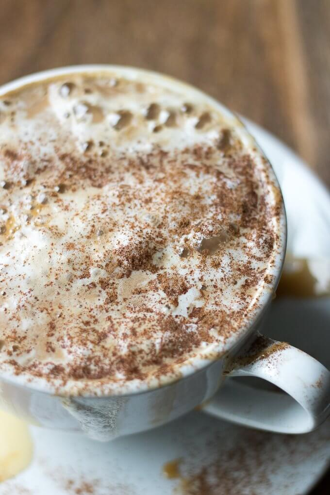 This White Chocolate Caramel Caffè Mocha is a sweet, spiced espresso drink that can be enjoyed hot or iced, perfect for cool Winter months when you need a warm drink or hot weather when you need a refreshing pick-me-up. This recipe has Torani White Chocolate and Caramel Sauces for a sweet and flavorful taste! #ad #ToraniSauceObsession #collectivebias @walmart #mocha #caffemocha #coffee #espresso #cinnamon #whitechocolate #caramel #hot #iced #drink #recipe
