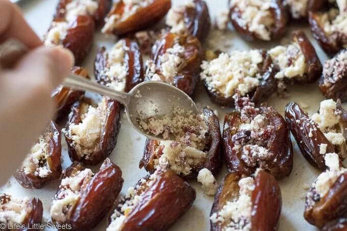 Bacon Wrapped Stuffed Dates are a savory-sweet appetizer or snack, served hot, perfect for having at a gathering. Pitted Medjool dates stuffed with soft cheese like Blue or Stilton Cheese, then wrapped with thick-sliced bacon and baked on a cast iron grill pan (or rimmed baking sheet). They are so delicious and mouthwatering that you can never have just one! #bacon #recipe #dates #Stilton #stuffeddates #hotappetizers #appetizers #gameday #Christmasfood #christmas