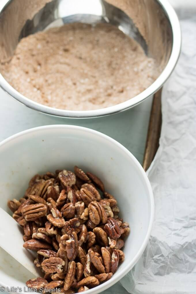 Candied Pecans are a spiced, salty-sweet snack perfect for an edible gift! They are easy to make and easily customizable to your tastes. My version has halved pecans, cinnamon, regular & brown sugar, maple syrup, pure vanilla extract, a little bit of ground nutmeg and Harrissa seasoning.  #pecans #ediblegifts #candiedpecans #harissa #cinnamon #snacks #recipe #brownsugar #maplesyrup